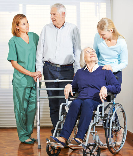 two elderly with their caregivers