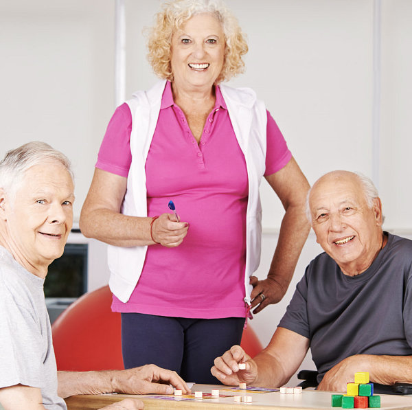 three elderly playing board games